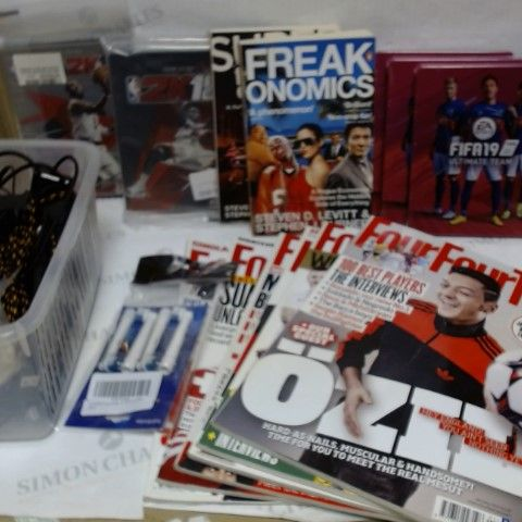 LOT OF APPROXIMATELY 8 ASSORTED HOUSEHOLD ITEMS, TO INCLUDE FOOTBALL MAGAZINES, VARIOUS CABLES, VIDEO GAME STEELBOOKS (GAMES NOT INCLUDED), ETC
