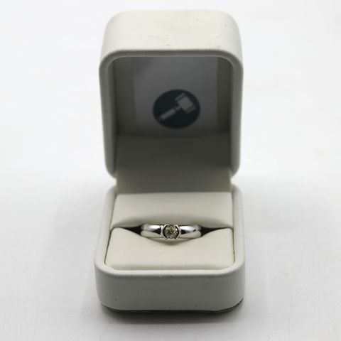 DESIGNER HEAVY 18ct WHITE GOLD SOLITAIRE RING SEMI RUB-OVER SET WITH A DIAMOND WEIGHING +-0.52ct