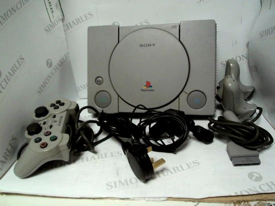 ORIGINAL PLAY STATION WITH APPROX 7 GAMES