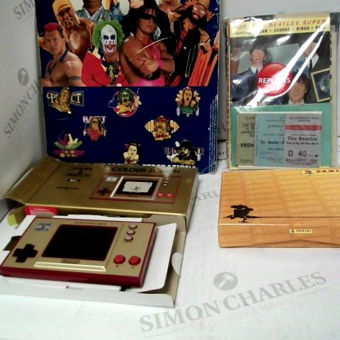 LOT OF APPROX 4 ASSORTED ITEMS TO INCLUDE: 7 WWF BADGES, GAME & WATCH BALL NINENDO  COLOUR SCREEN