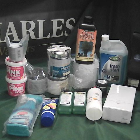 LOT OF ASSORTED HOME LIQUID ITEMS TO INCLUDE OLIVE FEED, PINK STUFF CLEANING PASTE, PVA GLUE