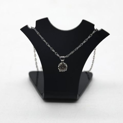 DESIGNER 18ct WHITE GOLD PENDANT ON CHAIN, SET WITH A DIAMOND WEIGHING +-0.62ct