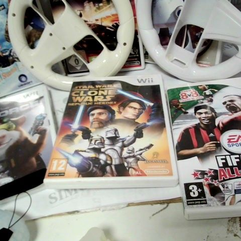 LOT OF APPROX 10 WII RELATED ITEMS TO INCLUDE : 6 WII GAMES, 2 CONTROLLER COVERS, STEERING WHEELS FOR CONTROLLERS